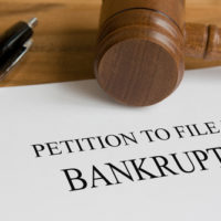 A gavel with a bankruptcy file