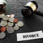 Jar of coins and a divorce sign